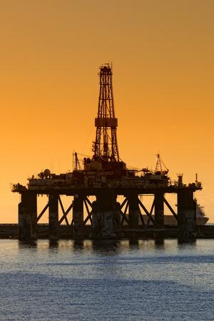 Sunrise on an oil plant photo