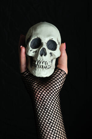 exorcism: Woman with a skull in his hand Stock Photo