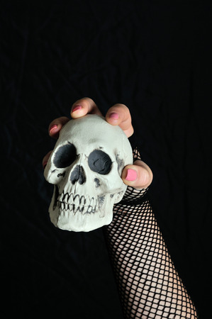beldam: Woman with a skull in his hand Stock Photo