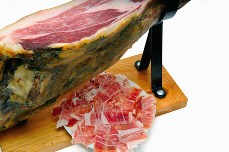 Iberian ham with a plate of slices of ham. Typical Spanish Stock Photo