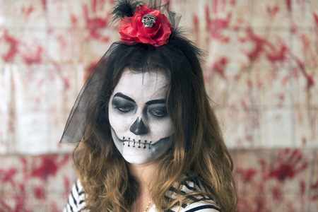 Girl with painted face, and characterized to celebrate Halloween