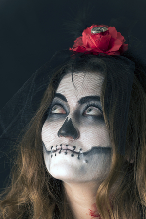 characterized: Girl with painted face, and characterized to celebrate Halloween