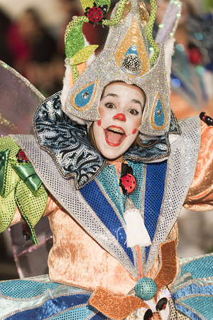 pace: TENERIFE, FEBRUARY 25: Carnival groups and costumed characters, parade through the streets of the city. FEBRUARY 25, Tenerife (Canary Islands) Spain.