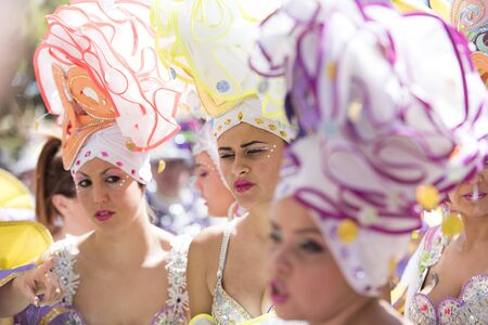 pace: TENERIFE, MARCH 05: Carnival of day, the groups meet with the  people. fun and colorful in the streets. March 05, 2017 Tenerife (Canary Islands) Spain Editorial