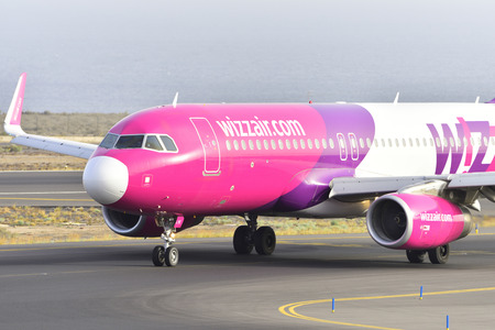 TENERIFE, SPAIN-JULY 17, 2017: Plane - Airbus A320-232 of Wizz Air at the waiting point to start the take off the airport of Tenerife South on July 17, 2017