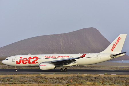 TENERIFE, SPAIN-JULY 17, 2017: Plane - Airbus A330-243 of Jet2.com, just landed in the airport of Tenerife South on July 17, 2017