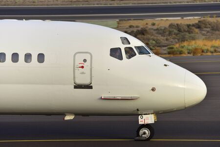 commander: TENERIFE, SPAIN-JULY 17, 2017: Plane - An old McDonnell Douglas MD-82, (1981) of ALK Airlines, just landed in the airport of Tenerife South on July 17, 2017 Editorial