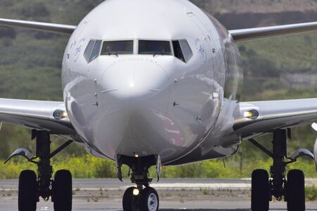 TENERIFE, SPAIN - JULY 27, 2017: Plane - First Officer of a Boeing 737, greeting from the cockpit after landing at TFN Airport. Tenerife North Airport on July 18, 2017