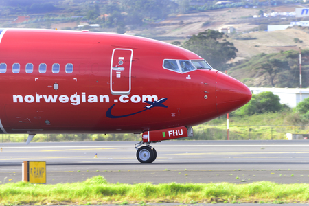 TENERIFE, SPAIN - OCTOBER 26, 2017: Plane Boeing 737-8JP, Norwegian, has just landed and goes to the parking lot. Tenerife North Airport on October 26, 2017