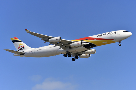 TENERIFE, SPAIN-MAY 14, 2018: Airbus A340-313 of Air Belgium, about to land at Tenerife South Airport on MAY 14, 2018 Editorial