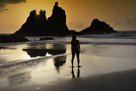 Silhouette of a woman on a lonely beach Stock Photo