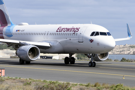 Las Palmas November 7, Airbus A320-214, Eurowings, by taxiway to start the takeoff. November 7, 2018, Las Palmas, (Canary Islands) Spain. Editorial