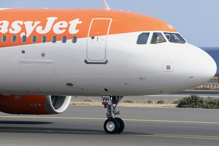 Las Palmas November 7, Airbus A320-251N, Easyjet, by taxiway, pilot and first officer, waving before takeoff. November 7, 2018, Las Palmas, (Canary Islands) Spain. Editorial