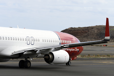 Las Palmas November 7, Boeing 737-8JP, Norwegian, by taxiway to start the takeoff. November 7, 2018, Las Palmas, (Canary Islands) Spain. Editorial