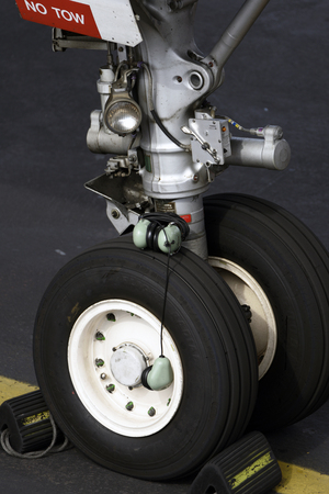 TENERIFE, SPAIN - DEC 04, 2018: Close-up of the front landing gear of a Airbus A319-112, Dec 04,2018