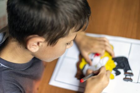Boy, drawing at home, doing his homework