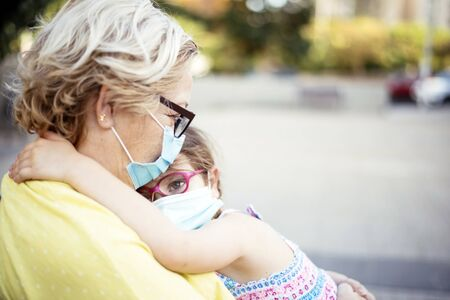 His grandmother's love during the COVID19 pandemic Stock Photo