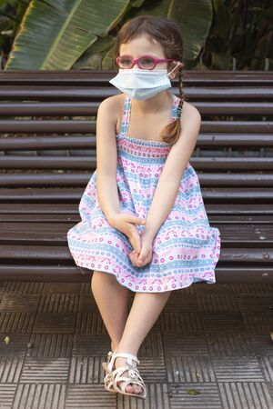 Girl with protective mask during the COVID19 pandemic