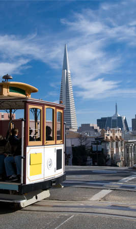 cable car: A San Francisco cablecar, with the Transamerica building and Chinatown in the background.