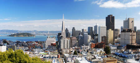 San Francisco skyline looking eastward from the Russian Hill area. This is a seamlessly stiched panoramic shot with a lot of sharp detail. Most of the famous landmarks are in this shot: Bay Bridge, Transamerica building, BofA Building, Coit Tower etc. Yer photo