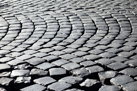 cobblestones: Geometrical pattern made of cobblestones in Rome Stock Photo