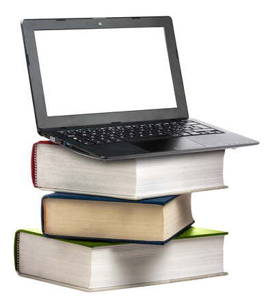 computer isolated: Laptop with blank display on stack of books isolated
