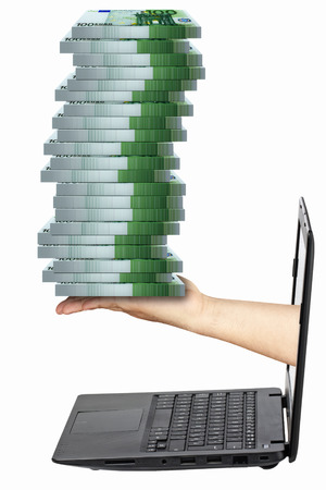 payola: Hand holding pile of packs of 100 euro banknotes coming out from laptop isolated
