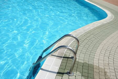crystal clear: Ladder in crystal clear blue swimming pool