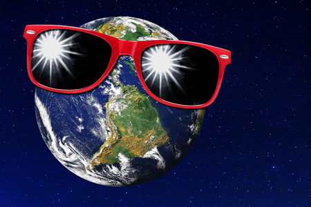 desertification: Earth wearing red sunglasses against starry universe