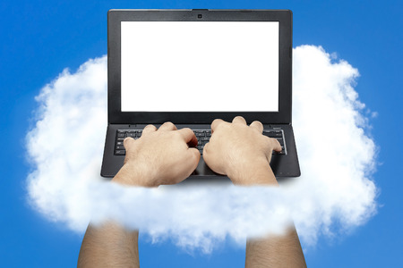clouding: hands typing on laptop keyboard front view on a cloud