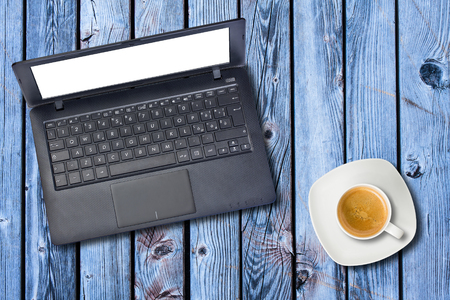 whitespace: Top view blank laptop computer display and coffee cup on wooden background