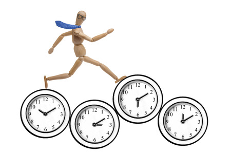 rushed: Wooden businessman mannequin running on clocks isolated Stock Photo
