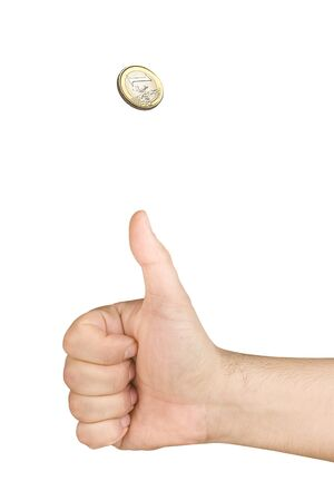 tossing: hand tossing one euro coin isolated