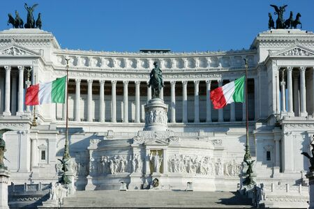 altar of fatherland: Italian Flags waving in front of Altar of the Fatherland or Altare della Patria in Rome Italy Editorial
