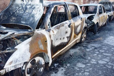 sabotage: Burned Parked cars on the road