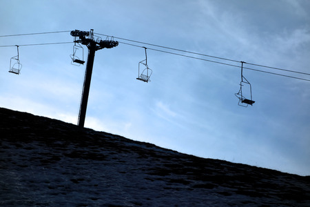wintersport: Silhouette of vacant chair lift Stock Photo