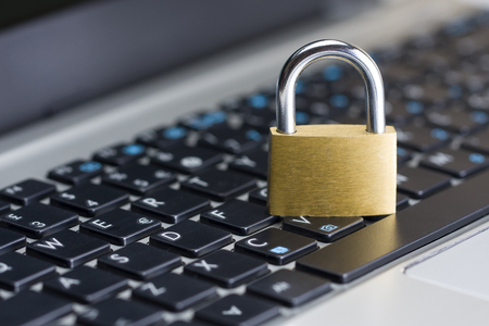 Computer security concept with a closed padlock on the keyboard Archivio Fotografico
