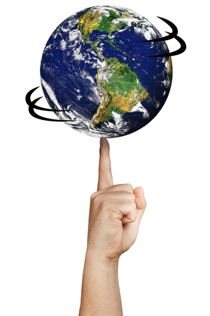 Earth world spinning on a finger isolated. Earth image provided by NASA