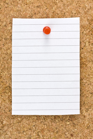 cork sheet: Vertical blank white striped sheet on cork board with a red small thumb tack Stock Photo