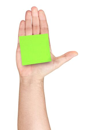 affixed: Blank green postit glued on male hand palm of hand up isolated Stock Photo
