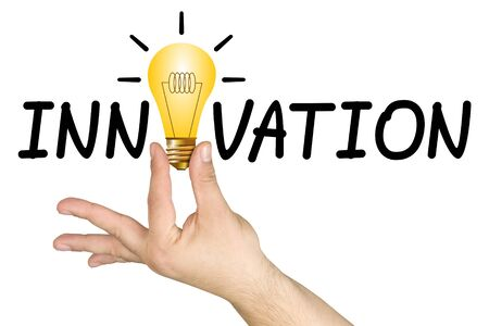 innovation word: Hand holding drawn light bulb among letters of the word innovation isolated Stock Photo