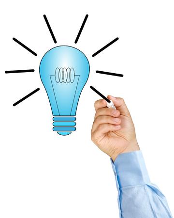 felt tip: Businessman hand with felt tip pen drawing light bulb idea isolated Stock Photo