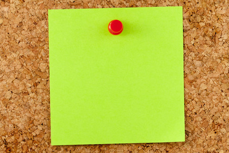 affixed: Blank green affixed on cork board with red thumbtack