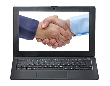 concordance: laptop displaying closeup of businessmen handshaking isolated