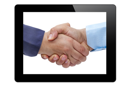 handshaking: Businessmen handshaking on tablet PC screen isolated
