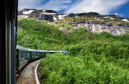 Flam, Norway - 2016 June: Flamsbana train going on Flam Railway in Flam, Norway Editorial