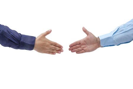 Two male business hands are about to handshake isolated