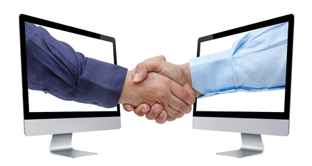 Businessman handshaking coming out from perspective view of computer screens isolated Stock Photo