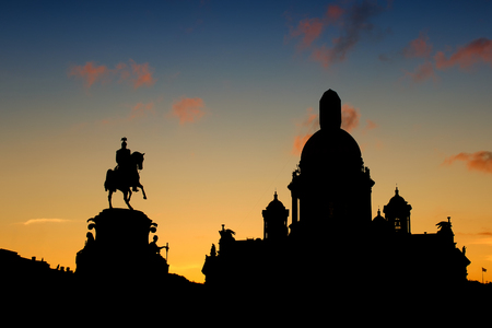 isaac s: Silhouette of the bronze equestrian monument to Nicholas I and Saint Isaac s Cathedral in St. Petersburg Russia Stock Photo