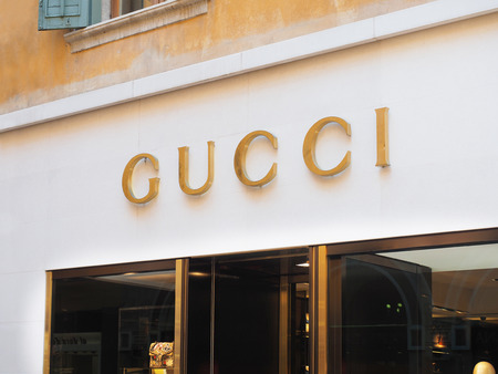 gucci store: Verona, Italy - August 2016: golden Gucci sign of a store Editorial